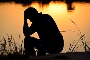 bigstock-depressed-man-sitting-on-top-o-48751034